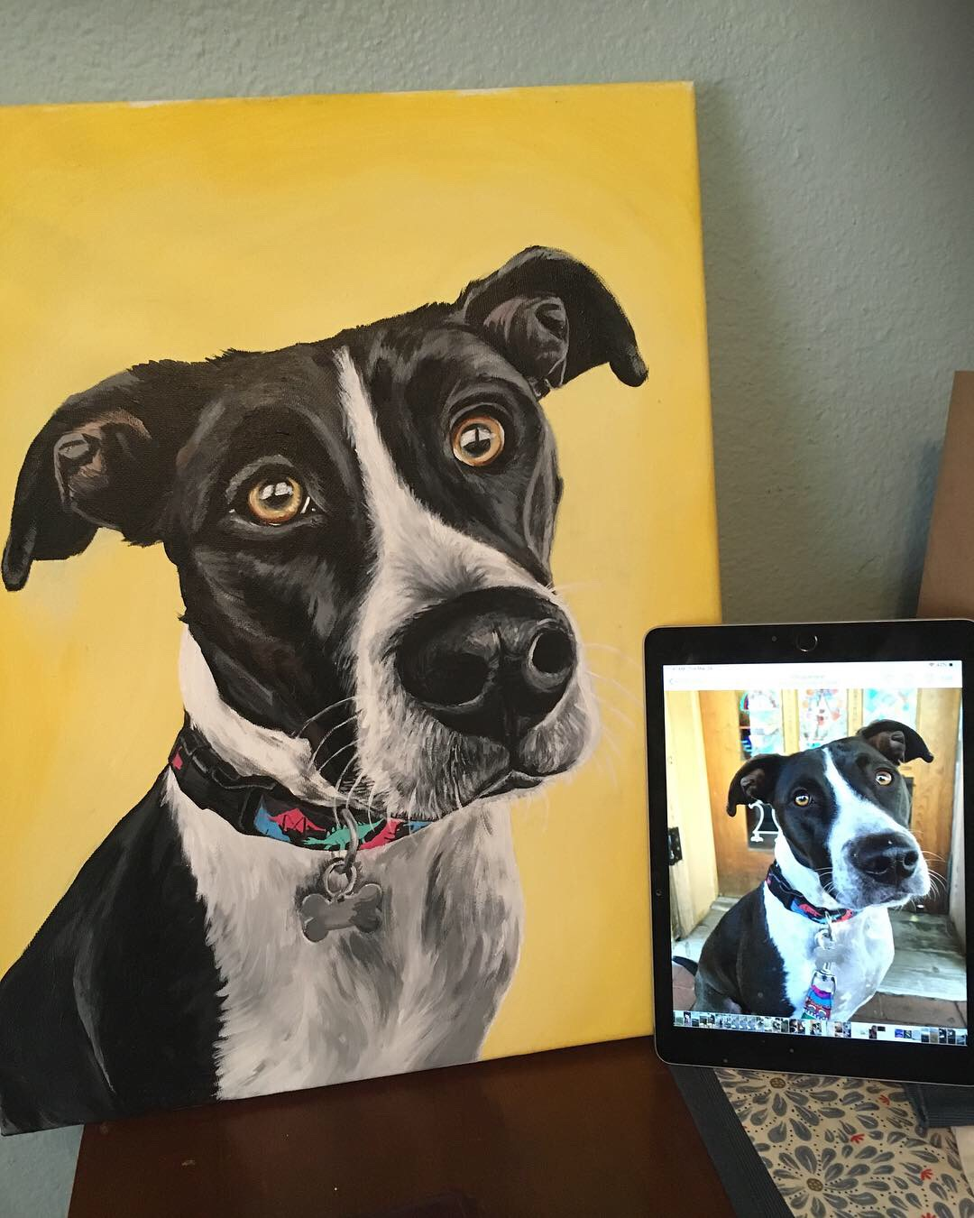 Dog painting based of picture next to it