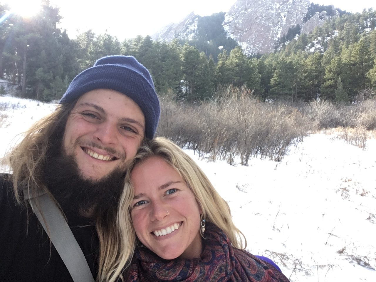 Couple in front of snow and mountain