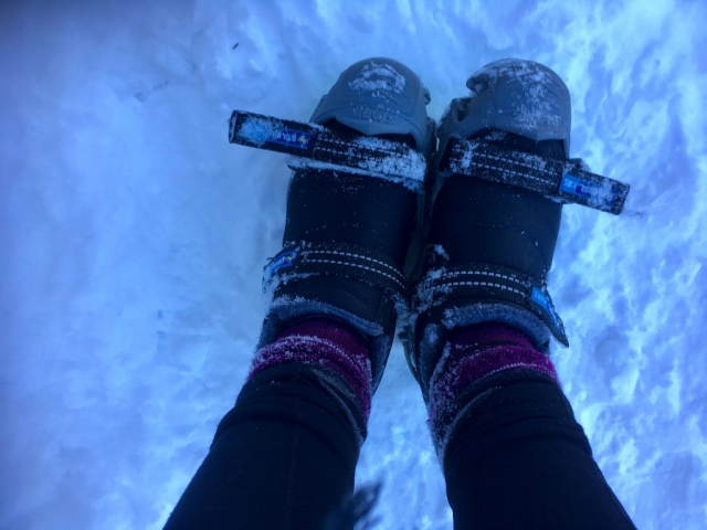 Shoes in spikes on snow