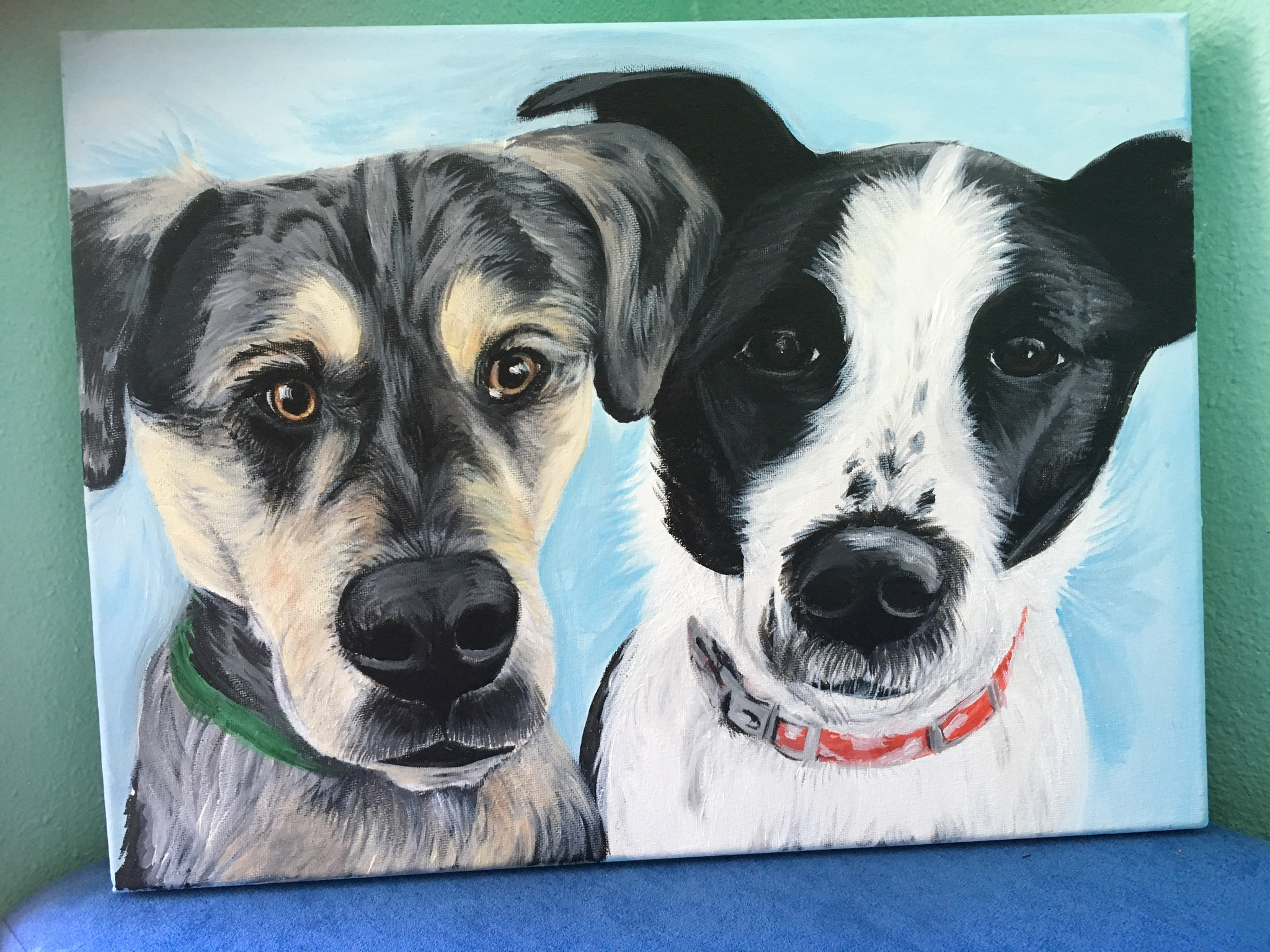 Two dogs in painting