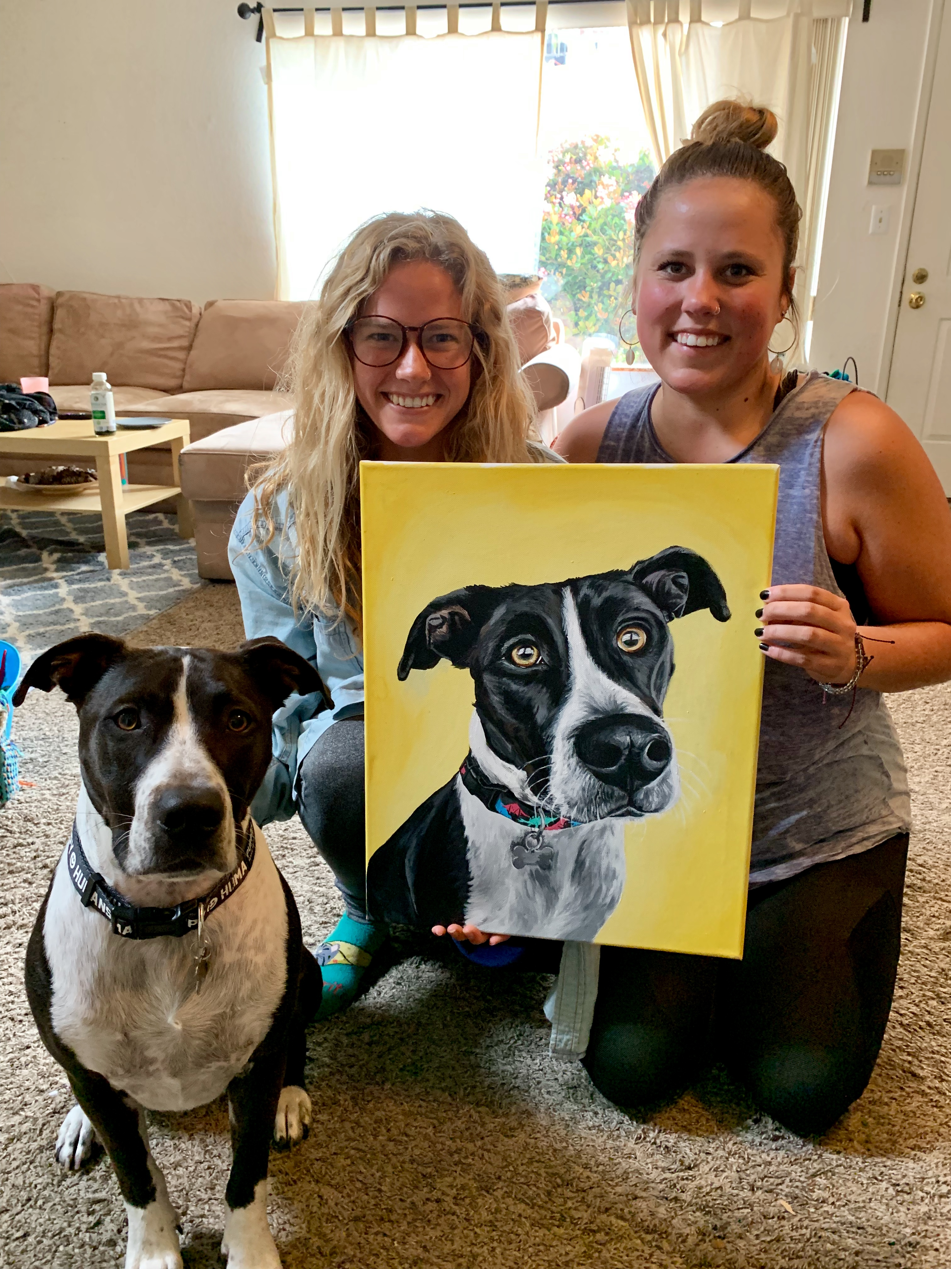 Girls with pet painting and dog