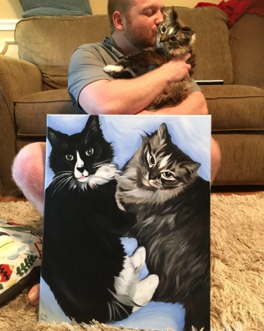 man with cat and cat painting