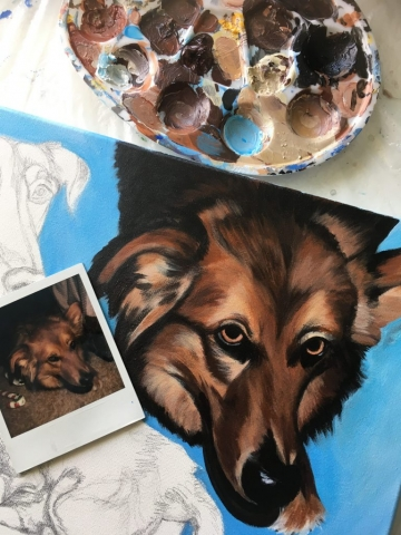 dog painting with polaroid near it