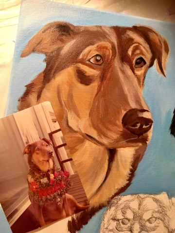 dog painting with picture in front