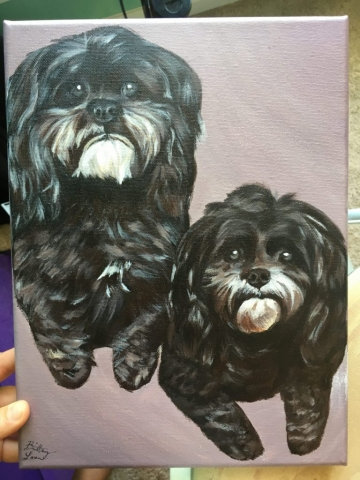 two puppies painting