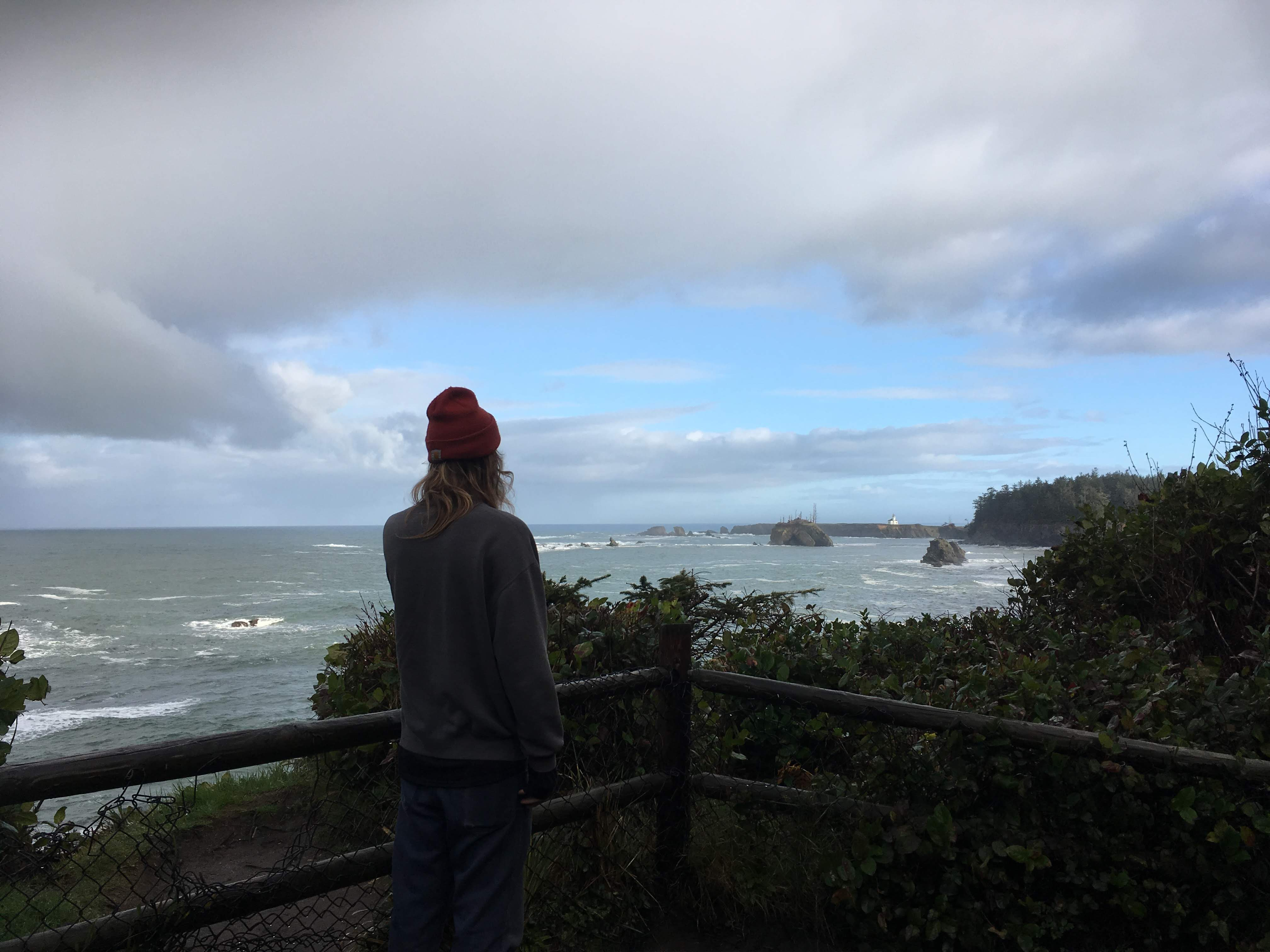 boy in front of sunset bay