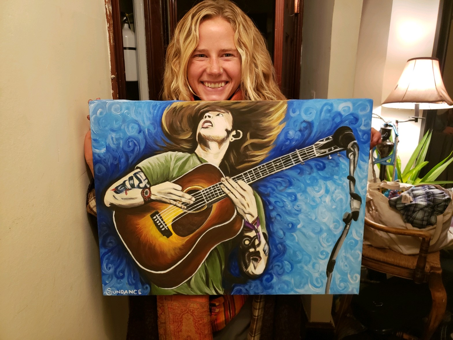 artist holding billy strings portrait