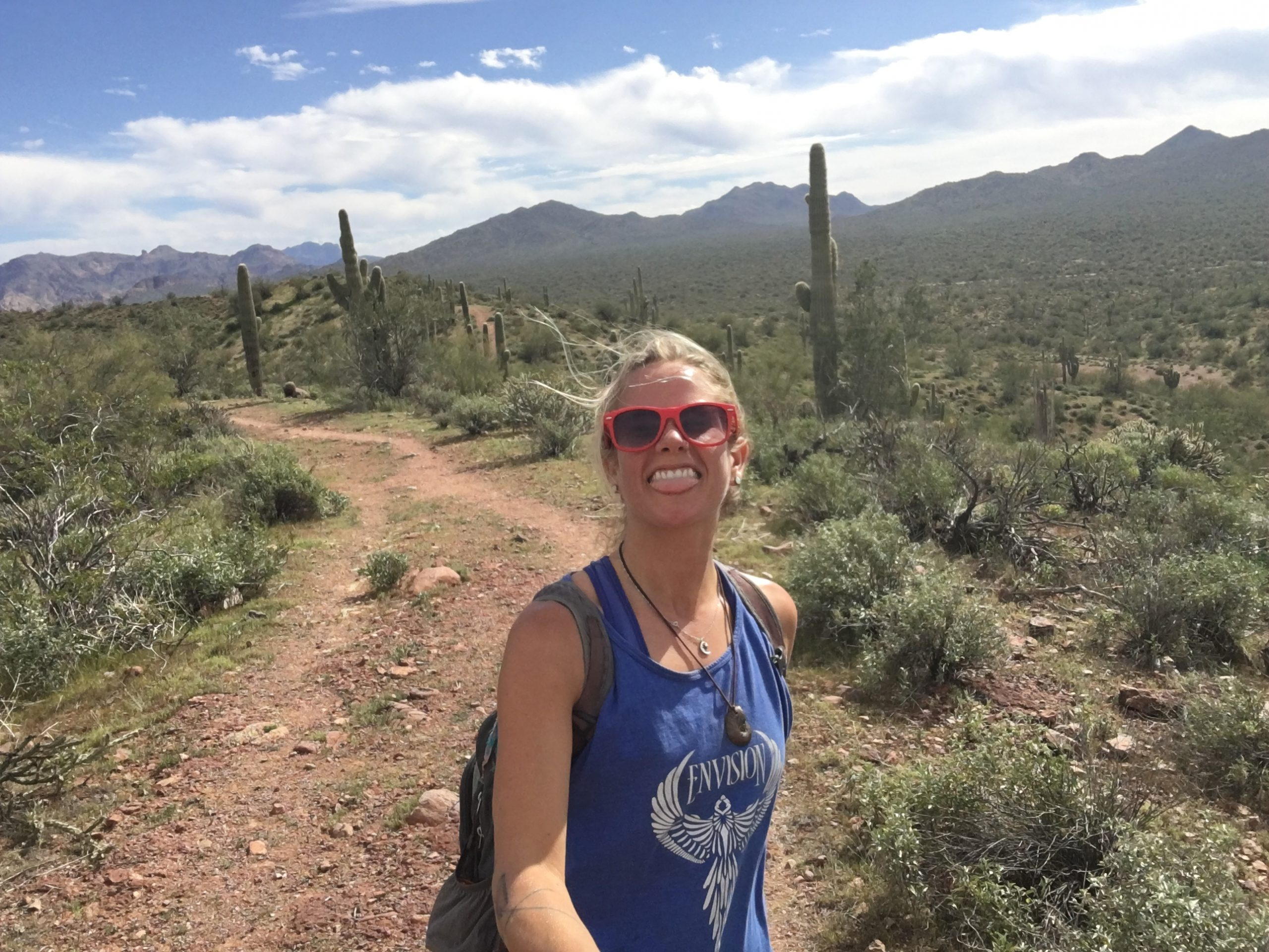 girl with cacti on trail