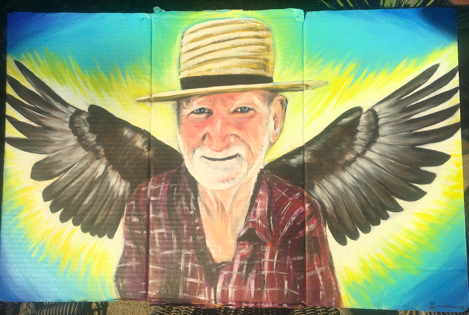 painting of man with hat and eagle wings