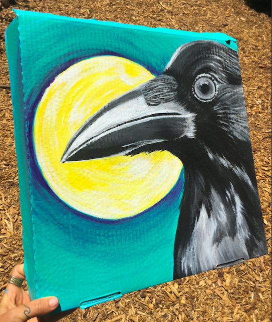 raven painting on pizza box