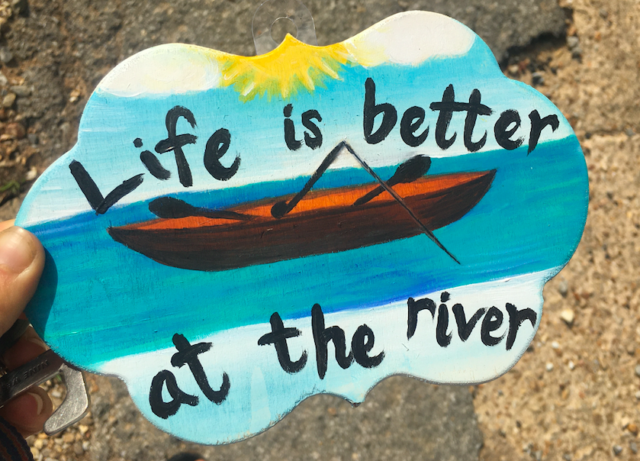 river and canoe sign